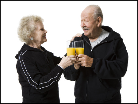 aging woman: Older Couple In Track Suits Taking A Juice Break