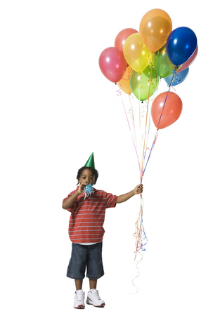 kids birthday party: Young Boy With Balloons LANG_EVOIMAGES