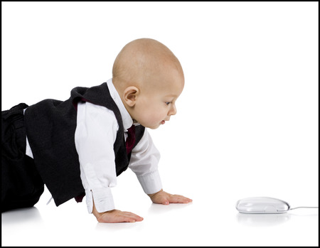 Baby Boy In Suit Crawling To Computer Mouse
