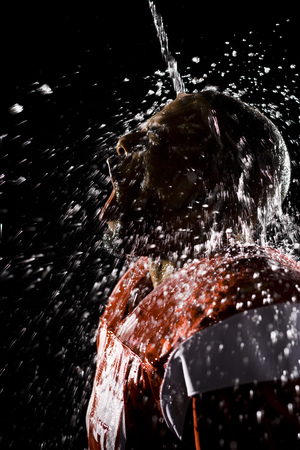 man drinking water: Football Player Cooling Off With Water