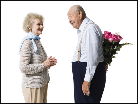 aging woman: Older Man With Bouquet Of Pink Roses Behind Back LANG_EVOIMAGES