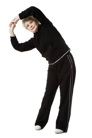 aging woman: Older Woman Doing Stretching Exercises