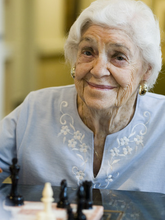 aging woman: Elderly Woman Playing Chess