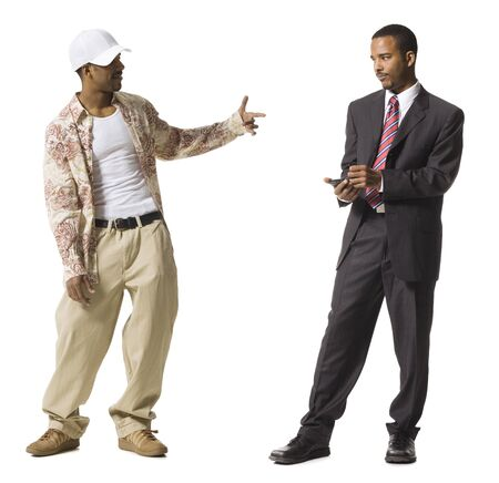 personal organiser: Businessman And Casually Dressed Twins LANG_EVOIMAGES
