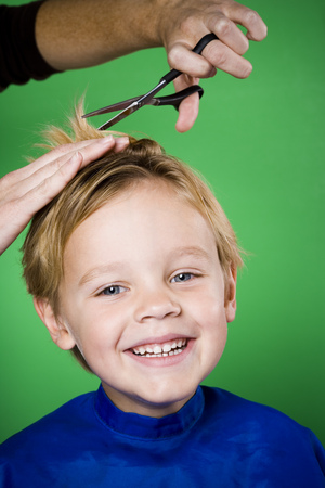 Boy Having His Hair Cut Smiling