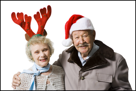 aging woman: Older Couple Wearing Christmas Hats