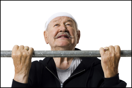 aging face: Older Man Doing Chin Up Exercises