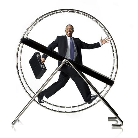 Businessman In Rodent Wheel Smiling LANG_EVOIMAGES