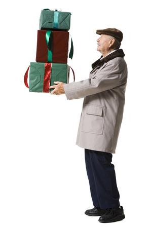 aging face: Older Man Holding Presents LANG_EVOIMAGES