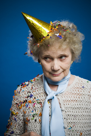 aging woman: Older Woman Wearing A Party Hat
