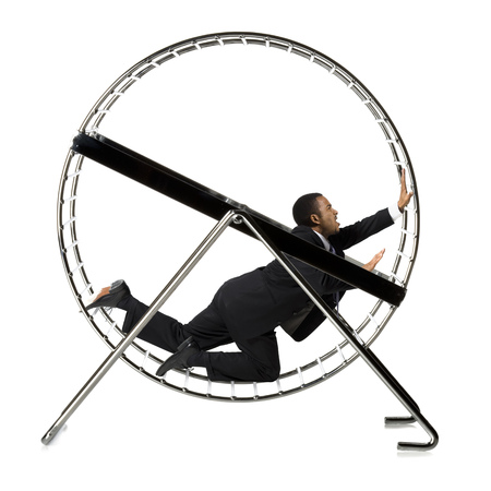 Businessman Crawling In Rodent Wheel LANG_EVOIMAGES