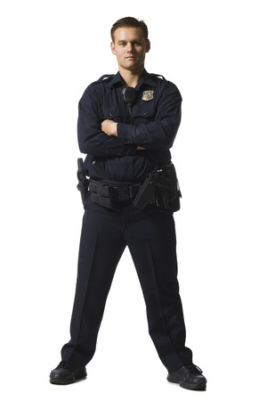 Male Police Officer Standing With Arms Crossed LANG_EVOIMAGES