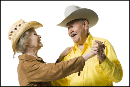 aging woman: Older Couple In Western Clothing Dancing LANG_EVOIMAGES