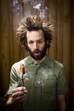 or electrocution: Man With Smoking Hair And Electrical Plug LANG_EVOIMAGES