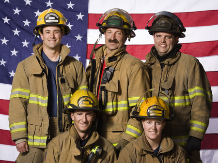 five stars: Group Portrait Of Firefighters With Us Flag LANG_EVOIMAGES