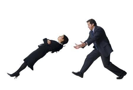 Businessman Catching Falling Businesswoman LANG_EVOIMAGES