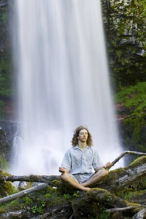 Man Doing Yoga Outdoors By Waterfall LANG_EVOIMAGES