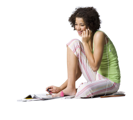 african american woman silhouette: Teenage Girl With Braces Talking On Cell Phone And Painting Toenails LANG_EVOIMAGES