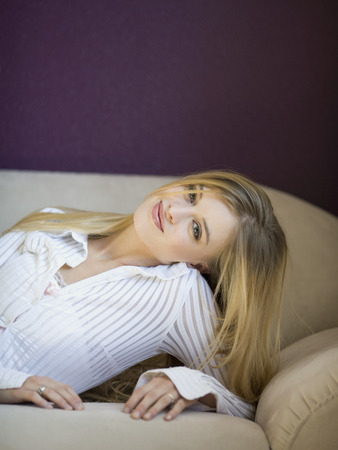 waist down: Woman Laying On Sofa Smiling