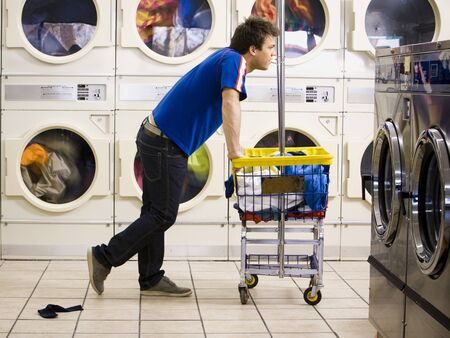 dryer: Man With Trolley At Laundromat