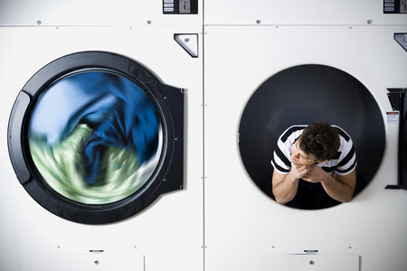 dryer: Man In Dryer Watching Laundry