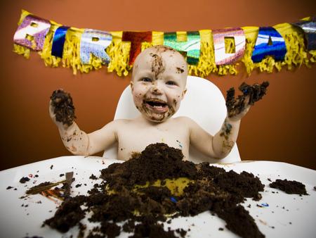 Baby Eating Birthday Cake