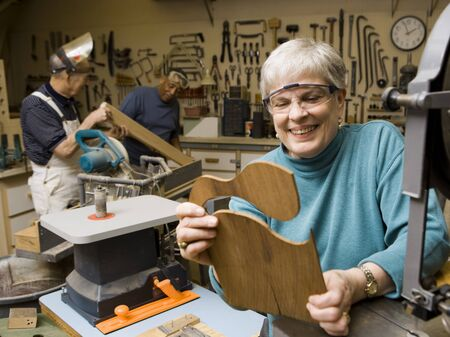 aging woman: Mature Woman In Wood Shop Smiling