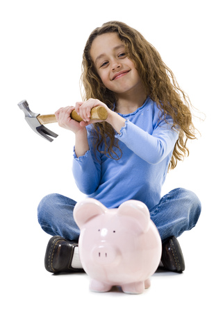 cross legs: Girl Sitting Cross Legged With Hammer And Piggy Bank Smiling LANG_EVOIMAGES
