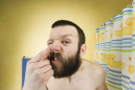 nose close up: Man With Beard In Bathroom Picking Nose LANG_EVOIMAGES
