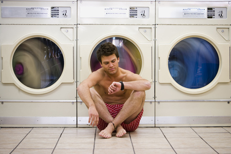 dryer: Man Sitting In Boxers At Laundromat Checking Watch