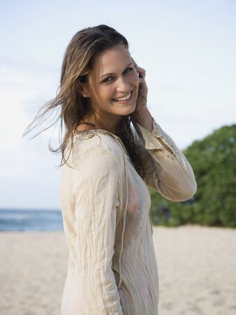 Woman On Beach Smiling LANG_EVOIMAGES