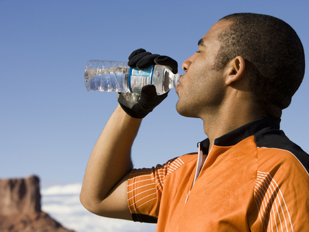 man drinking water: Profile Of Man Drinking Bottled Water Outdoors