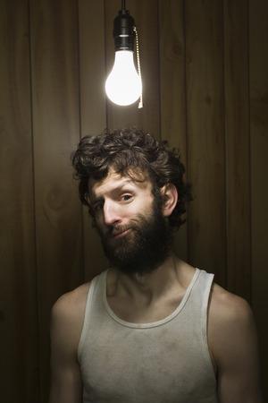 Man Standing Under Light Bulb LANG_EVOIMAGES