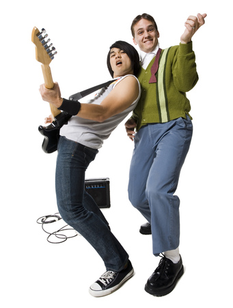 Young Man With Electric Guitar And Young Nerd Playing Air Guitar LANG_EVOIMAGES