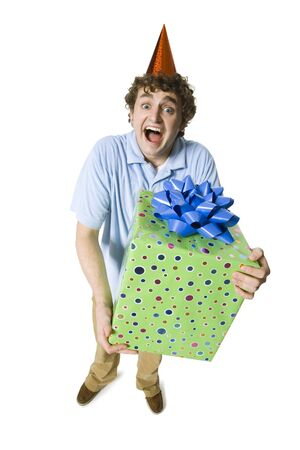 Man With Party Hat Holding Gift Box Smiling