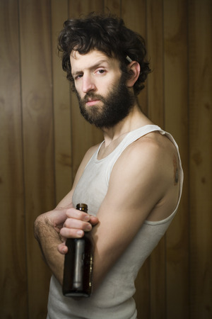 Man Standing With Crossed Arms And Beer Bottle LANG_EVOIMAGES