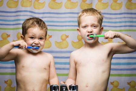 Two Boys Brushing Teeth In Bathroom Sink