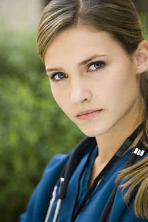 registered nurse: Portrait Of A Female Nurse Outdoors With Stethoscope LANG_EVOIMAGES