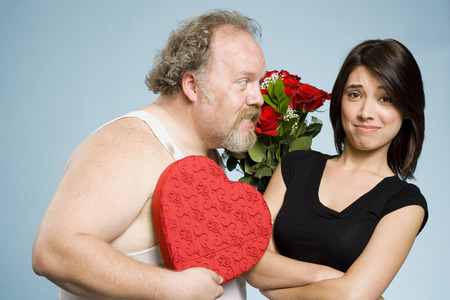 Disheveled Man With Heart Box And Roses With Disinterested Woman