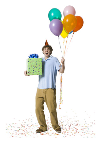 Man With Party Hat Holding Balloons And Gift Box
