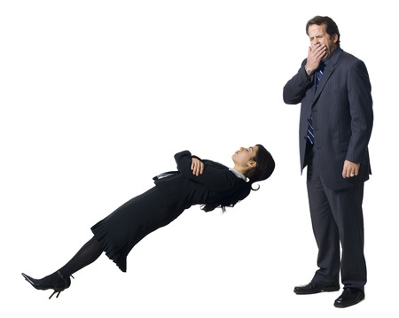 careless: Businesswoman Levitating With Businessman Yawning