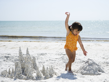 Young Girl Playing At Beach With Sand Formations
