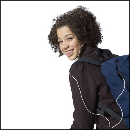 ruck sack: Girl With Backpack And Earbuds Smiling With Braces