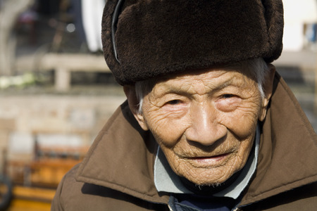 Closeup Of Old Man With Hat Outdoors