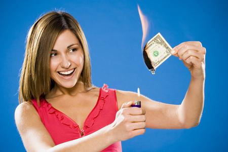 Woman Setting American One Dollar Bill On Fire