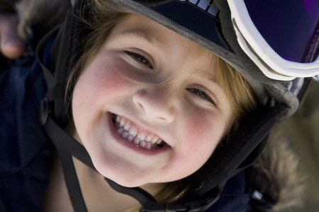 Young Girl With Ski Goggles Smiling