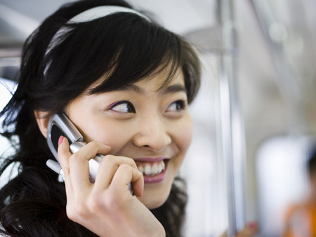 Closeup Of Teenage Girl Talking On Cell Phone Smiling