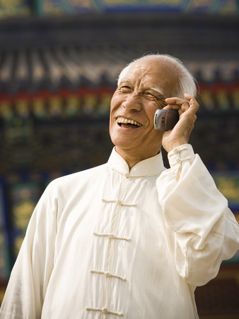 Man Talking On Cell Phone Outdoors Smiling