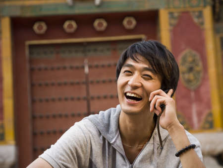 Teenage Boy Outdoors With Cell Phone Smiling