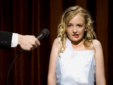 cowering: Girl Beauty Pageant Contestant With Microphone Looking Nervous